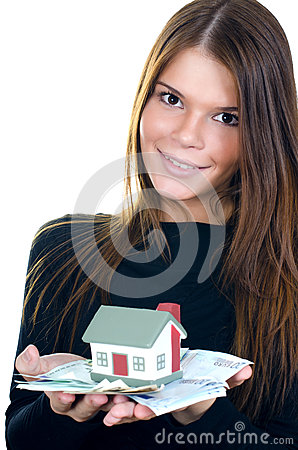 Business woman with the toy house and banknotes