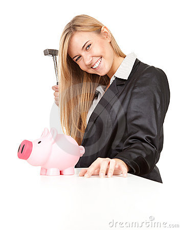 Business woman trying to break pink piggy bank