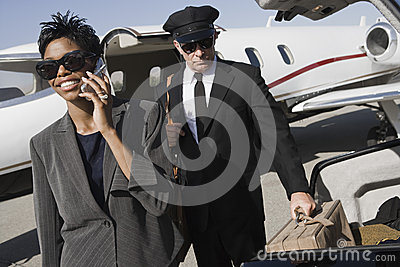 Business Woman Using Cellphone At Airfield