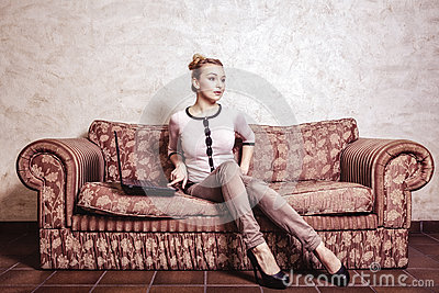 Business woman using computer. Internet home technology. Vintage photo. Stock Photo
