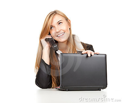 Business woman using her mobile phone and laptop