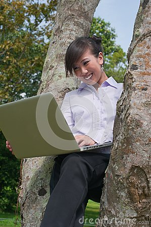 Business woman using laptop outdoor