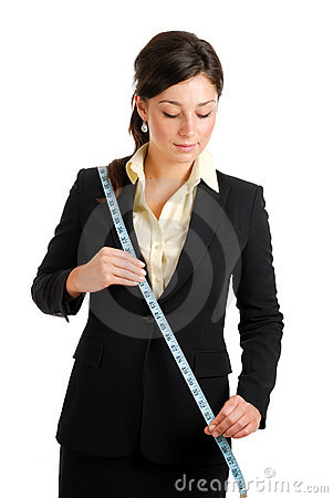 Business woman using a measuring tape