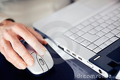 Business woman using a mouse at work