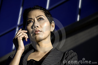 Business woman using smart cell phone