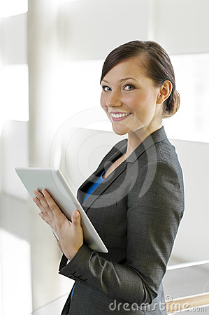 Business woman using a tablet computer