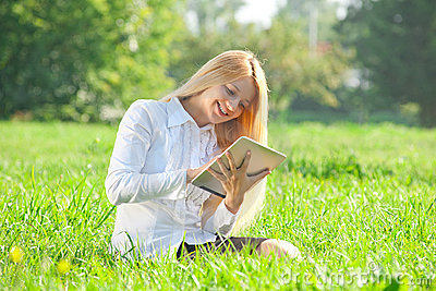 Business woman using tablet outdoors
