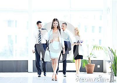Business woman walking in office