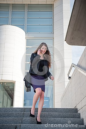 Free Business Woman Walking On Stairs Calling Phone Stock Photo - 24801340