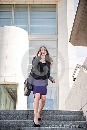 Free Business Woman Walking On Stairs Calling Phone Stock Image - 33660471