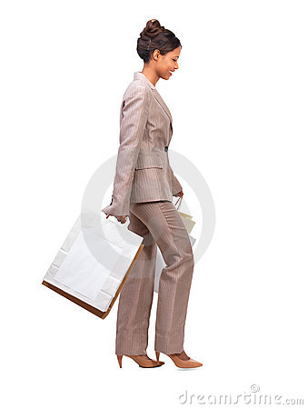 Business woman walking with shopping bags