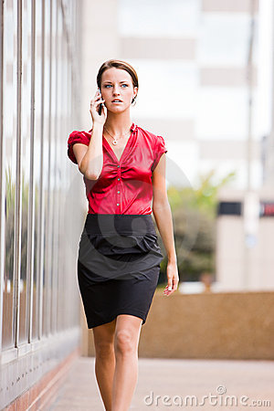 Free Business Woman Walking While Talking On Her Phone Royalty Free Stock Photo - 10516745