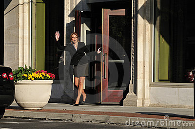 Business woman waving hello