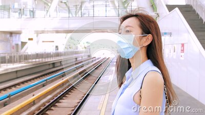 Business woman wearing face mask at train station stock footage