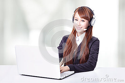 Business woman wearing headset with smile