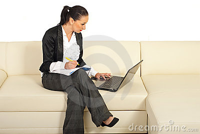 Business woman working on couch