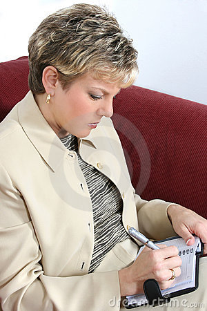 Business Woman Working at Home on Couch