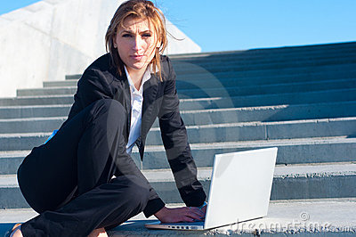 Business woman working on stairs