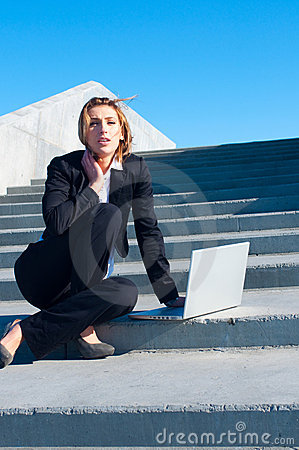 Business woman working on stairs, vertical
