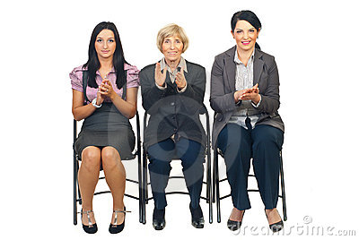 Business women on chair clapping