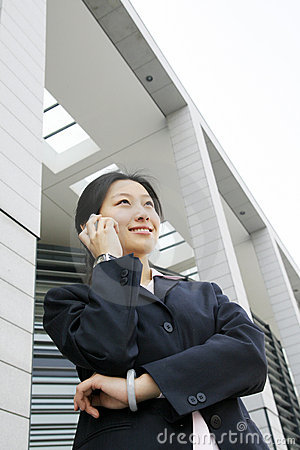 Business women holding  phone