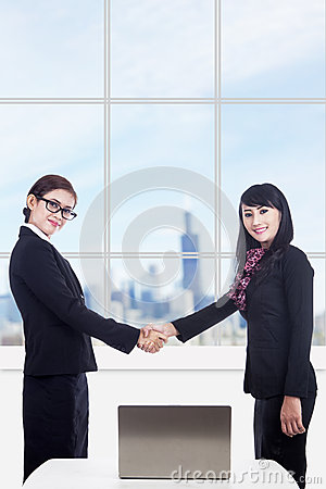 Business women partnership with laptop in office