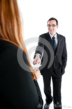 Business workers exchanging business cards