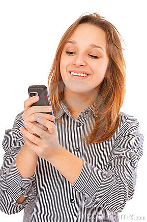 Businessgirl sending a text message with her phone