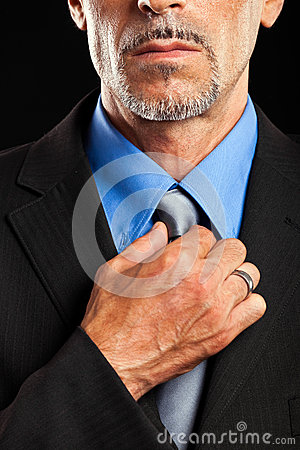 Businessman adjusting collar