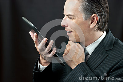 Businessman Admires Tablet