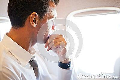 Businessman on airplane
