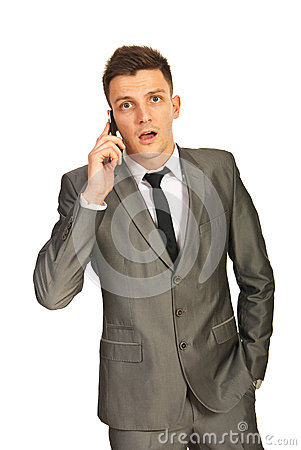 Businessman amazed by a phone call