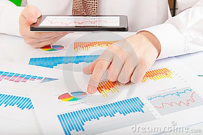 Businessman analyzing graphs and charts