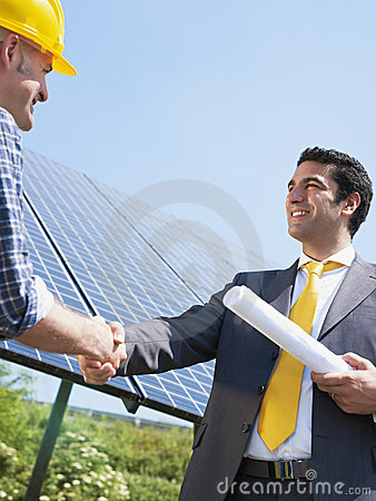 Free Businessman And Electrician Shaking Hands Stock Photos - 14478913