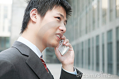 businessman  is answering phone outdoor