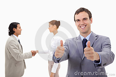 Businessman approving with hand shaking colleagues