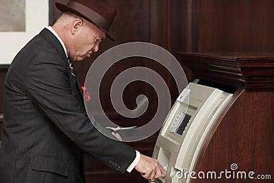 Businessman at an atm machine
