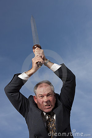 Businessman Attacking With A Sword