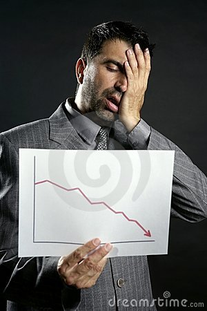 Businessman with bad sales reports chart