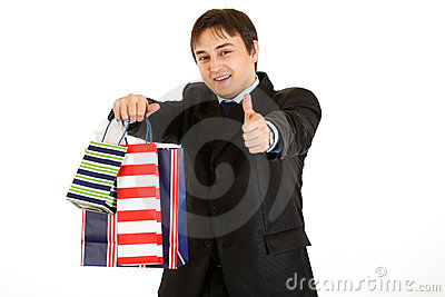Businessman with bags and showing thumb up gesture