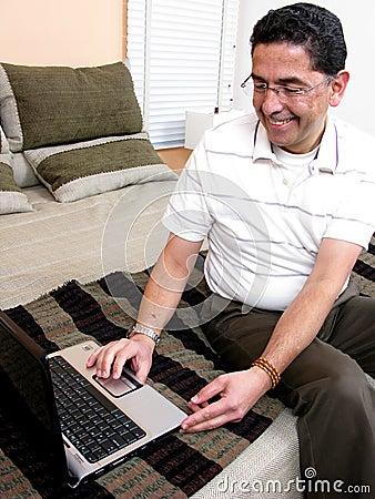 Businessman at bed looking at computer
