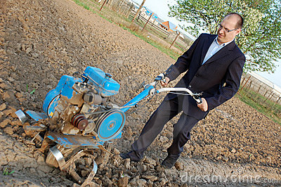 The businessman behind a tractor.