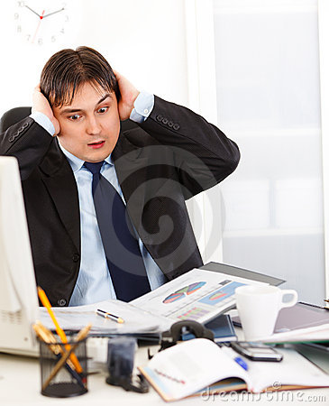 Businessman being overloaded with loads of work