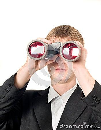 Businessman with binoculars searching
