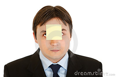 Businessman with blank adhesive note over mouth
