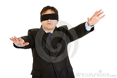 Businessman with blindfold covering his eyes