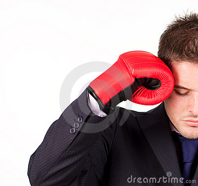 Businessman with boxing gloves to his head