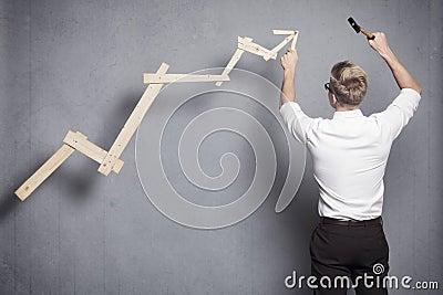 Businessman building business graph.