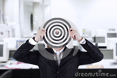 Businessman with bull s eye head at office