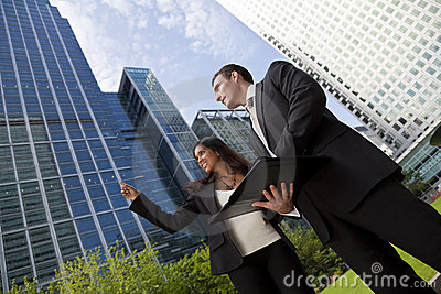 Businessman and Businesswoman In City